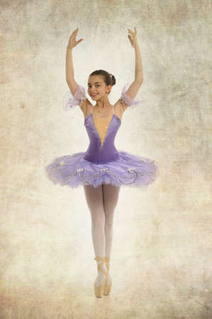 Young ballerina dancing gracefully in Vintage style photo