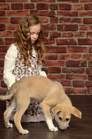 rhodesians: girl with a puppy Stock Photo