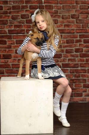 ridgebacks: girl with a puppy Stock Photo