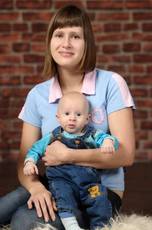 a young mother with a small child in her arms Stock Photo - 19221980