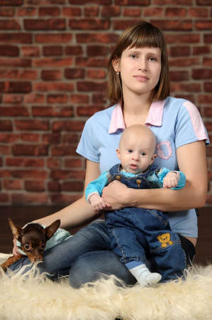 a young mother with a small child and a dog photo