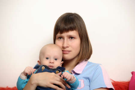 a young mother with a small child in her arms Stock Photo - 19221979