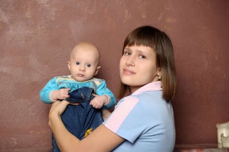 a young mother with a small child in her arms Stock Photo - 19224790