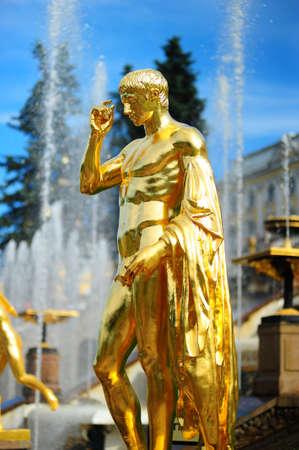 golden statues at Peterhof photo