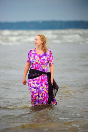 woman walking in the water along the beach Stock Photo - 18309072