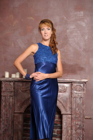 young woman in a blue dress photo
