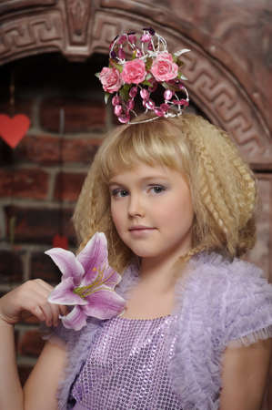 young princess wearing a crown of flowers Stock Photo - 18810594