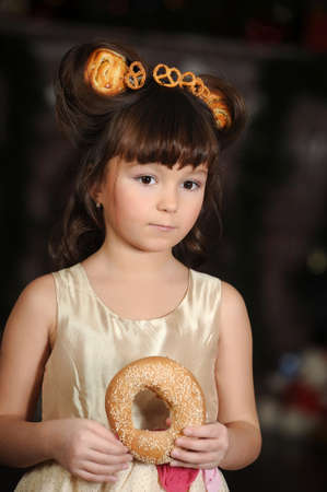 Girl with bread rolls photo