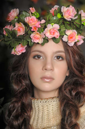 Young beautiful girl with a wreath of flowers on her head Stock Photo - 18855329