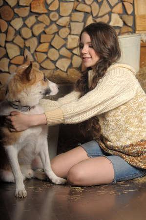 reprimanding: Teen girl with a dog mongrel Stock Photo
