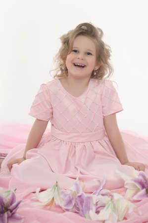 flowergirl: girl in a pink dress with flowers Stock Photo