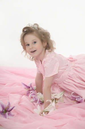 girl in a pink dress with flowers photo