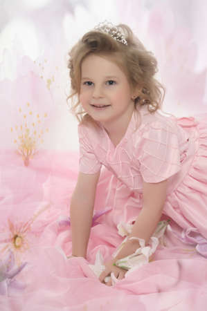 girl in a pink dress with flowers Stock Photo - 19000533