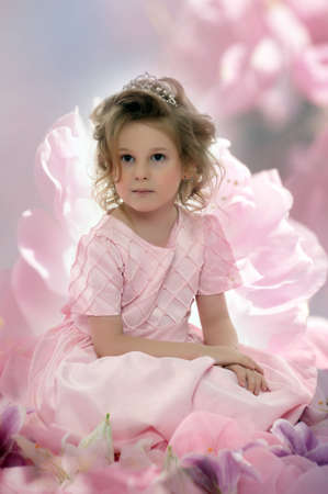 girl in a pink dress with flowers Stock Photo