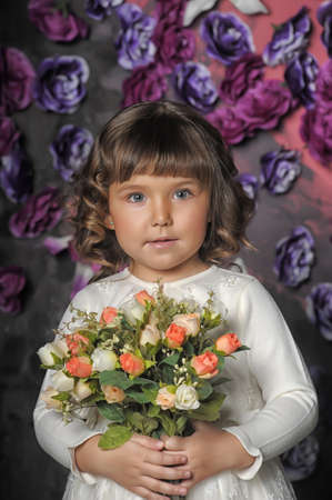 three year old girl with a bouquet of roses Stock Photo - 18971427