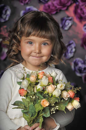 three year old girl with a bouquet of roses Stock Photo - 18971426