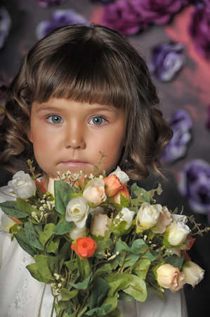 three year old girl with a bouquet of roses Stock Photo - 18971428