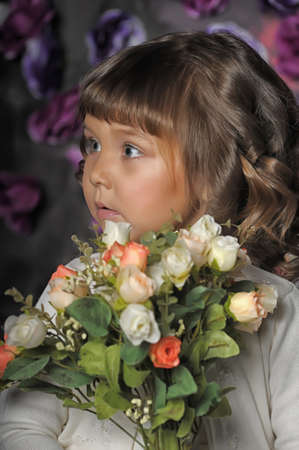 three year old girl with a bouquet of roses Stock Photo - 18971425