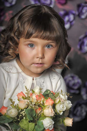 three year old girl with a bouquet of roses Stock Photo - 18971424