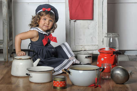 little girl in the kitchen of cookware Stock Photo - 19116276