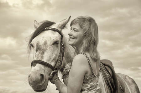 Woman   Horse in field or park  photo