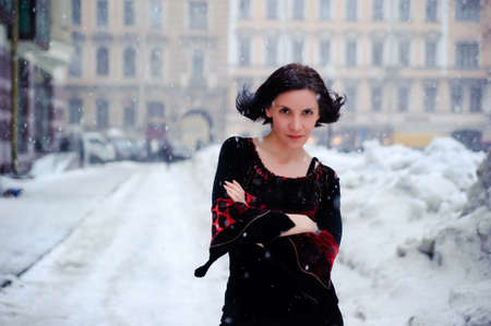portrait of a young woman in a winter city landscape photo