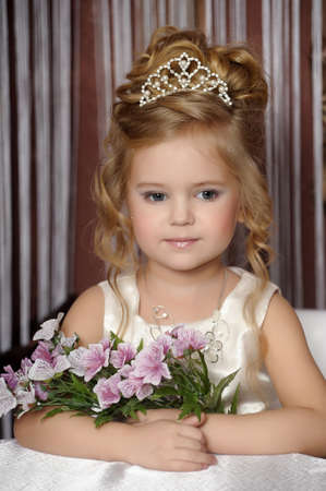 little princess in a white dress with a tiara on her head Stock Photo - 19902313