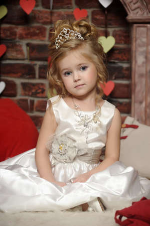 blondie: little princess in a white dress with a tiara on her head