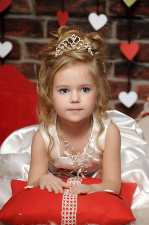 little princess in a white dress with a tiara on her head Stock Photo - 19428227