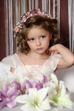complexion: Beautiful little girl in wreath of pink flowers