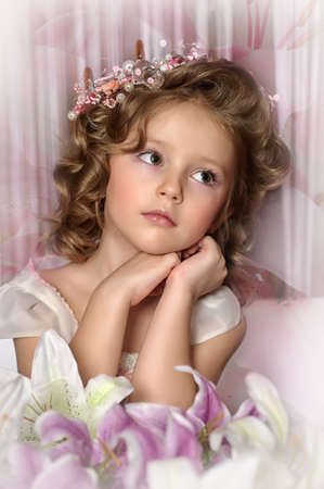 Beautiful little girl in wreath of pink flowers Stock Photo - 19593686