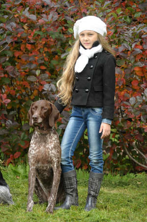 hunter playful: girl with a dog in the park
