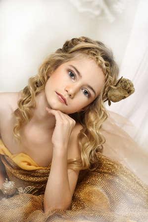 blonde blue eyes: girl in gold