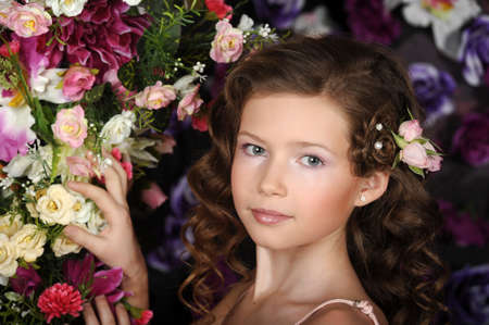 girl in a pink dress on a background of an arch of flowers Stock Photo - 19000547