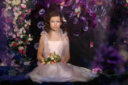 girl in a pink dress on a background of an arch of flowers Stock Photo - 19000548