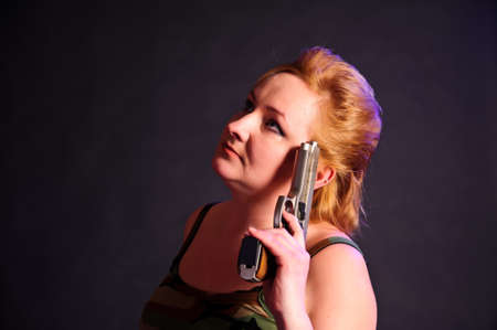 middle-aged woman with a gun photo