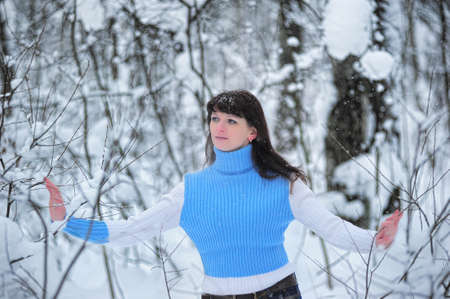 Young beautiful woman  in woodland snow scene photo