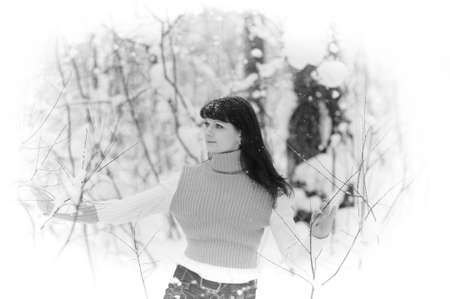 snowscene: Young beautiful woman  in woodland snow scene Stock Photo