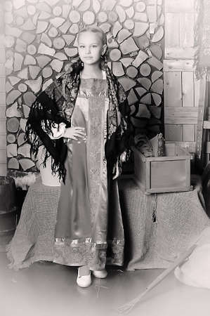 Retro picture of girl in national costume with Russ photo