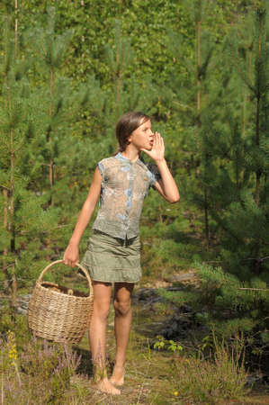 The girl with a basket in wood photo