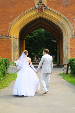 the bride and groom holding hands photo