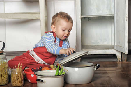 little boy in the kitchen Stock Photo - 19249352