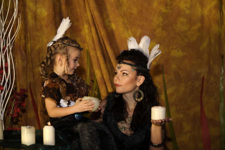 mother and daughter in costumes of American Indians photo