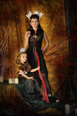 mephoto: mother and daughter in costumes of American Indians