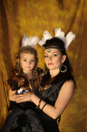 powow: mother and daughter in costumes of American Indians