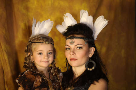 mother and daughter in costumes of American Indians Stock Photo - 18993763