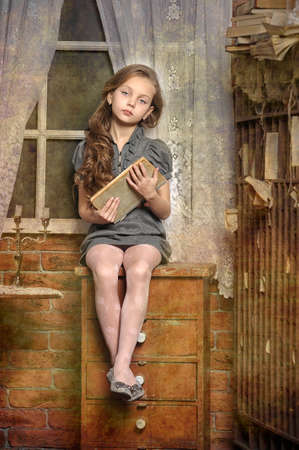 girl with a book in the old library Stock Photo