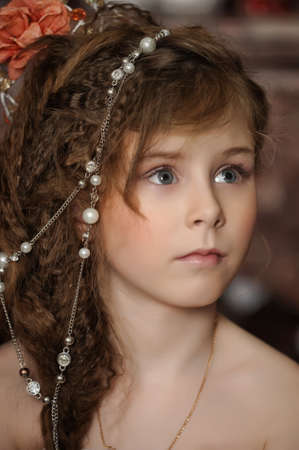 fantasize: girl with beads in her hair Stock Photo