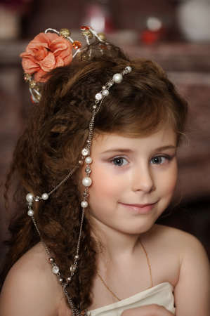 girl with beads in her hair photo