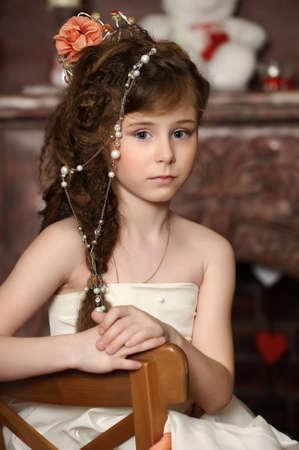 children acting: girl with beads in her hair Stock Photo